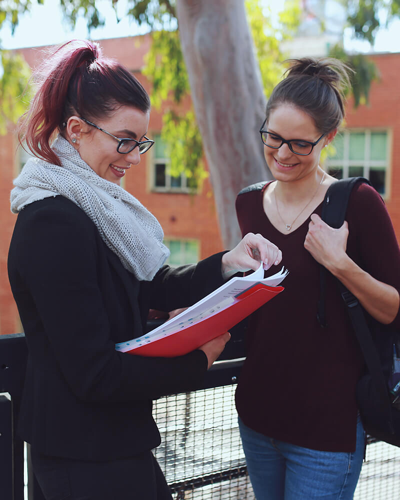 University students discussing Christian Editing outside on campus